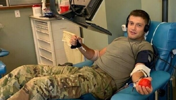 Soldier in chair, giving blood