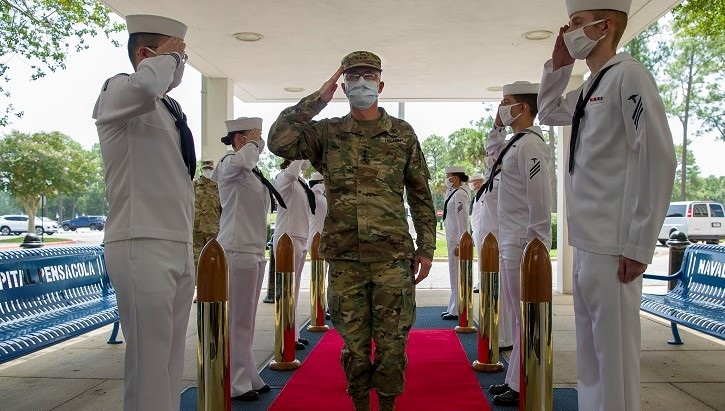 Lt. Gen. Ronald Place saluting to soldiers