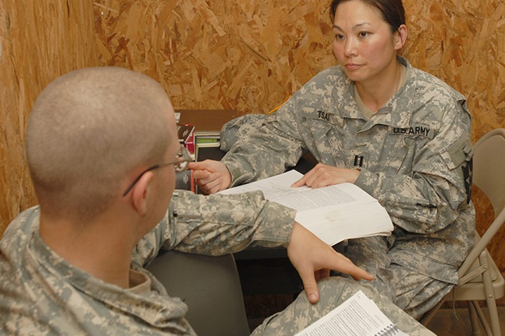 Capt. Michelle Tsai, the behavioral health officer for the 4th Brigade, 2nd Infantry Division, reviews medical information in her office at the Joint Readiness Training Center June 17. Tsai, an Alexandria, Va., native, is here with the Raider Brigade in support of training operations for the unit's upcoming deployment to Iraq. (Photo by Pfc. Luke Rollins)