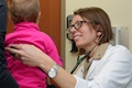 A Navy doctor examines a young patient. (U.S. Navy photo by Chief Mass Communication Specialist Michael O'Day/Released)
