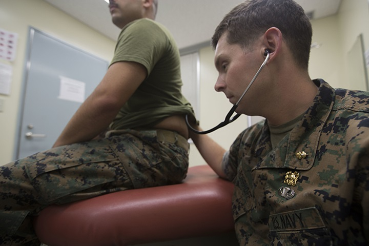A U.S. naval officer listens through his stethoscope to hear his patient's lungs at Camp Schwab in Okinawa, Japan in 2018. (U.S. Marine Corps photo by Lance Cpl. Cameron Parks)