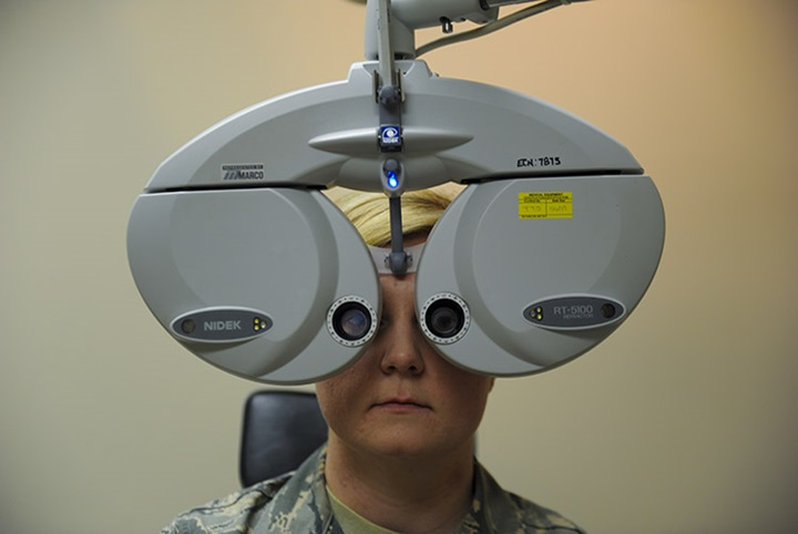 A phoropter is an instrument used to determine an individual's eyeglass prescription by measuring the eye's refractive error and switching through various lens until the persons vision is normal. (U.S. Air Force photo by Airman Dennis Spain)