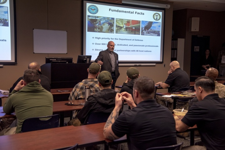 Todd Livick, Defense POW/MIA Accounting Agency Outreach and Communications director, speaks to U.S. Army Survival, Evasion, Resistance and Escape instructors about the DPAA mission at the U.S. Army S.E.R.E. school, Fort Rucker, Alabama. The DPAA and the Armed Forces Medical Examiner System provided information on their respective missions and held question and answer session with the Soldiers to provide a better understanding about the two agencies. (U.S. Air Force photo by Staff Sgt. Nicole Leidholm)