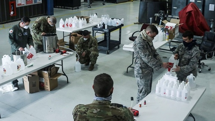 Military personnel packing sanitizing products