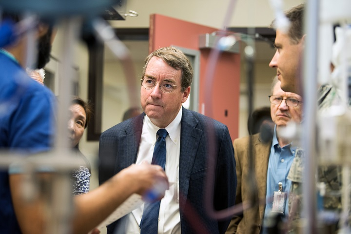 David Loftus M.D., PH.D, medical officer and principal investigator space biometrics research branch, NASA Ames Research Center, meets with members of the 60th Medical Group at Travis Air Force Base, California. NASA and David Grant Medical Center are meeting for a potential collaboration between the two organizations to help in future space exploration. (U.S. Air Force photo by Louis Briscese)