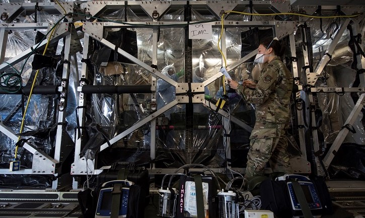 Military Captain and team cleaning large, plastic enclosed space