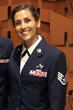 Ms. Arenas smiling, in uniform