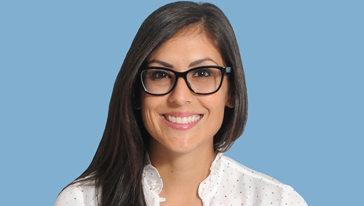 Photo of woman wearing glasses in a white blouse