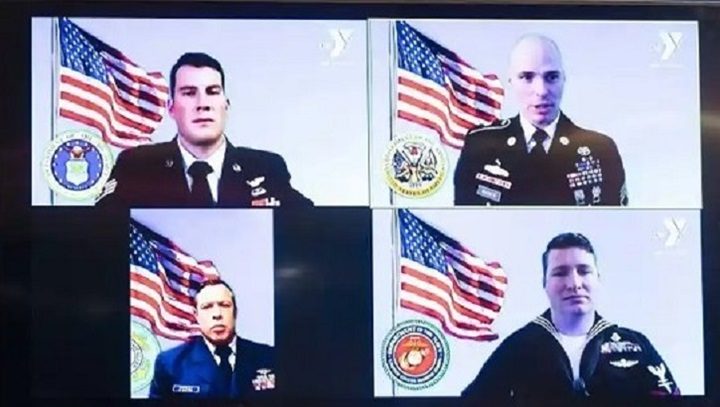 Four military personnel shown during a Zoom call
