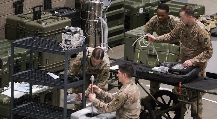 Image of soldiers unpacking equipment