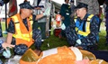 Navy Lt. Cmdr. Reginaldo Cagampan, left, and Navy Hospital Corpsman 1st Class Rocky Pambid, members of the U.S. Naval Hospital Yokosuka Emergency Response Team, treat a simulated patient during the 2016 Big Rescue Kanagawa Disaster Prevention Joint Drill in Yokosuka city, Japan. Multiple agencies took part in the drill including the U.S. Navy, Army and Air Force, as well as personnel from the Japan Self-Defense Force and Japanese government agencies. (U.S. Navy photo by Greg Mitchell)