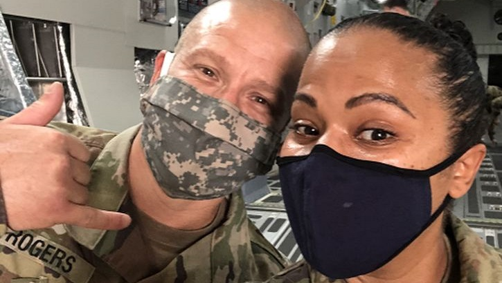 Military personnel wearing face mask posing for a picture