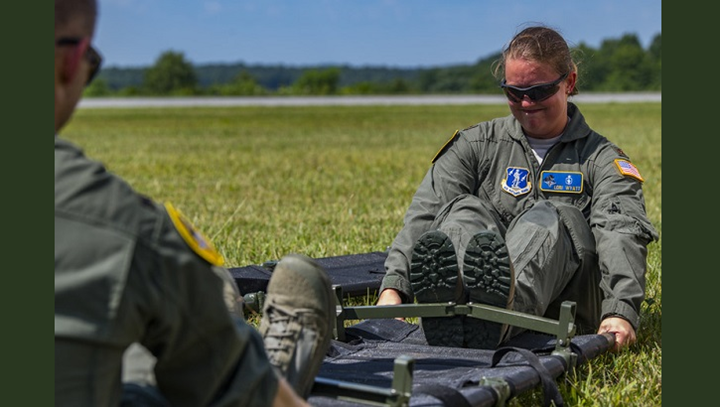Air Force Maj. Lori Wyatt, a Critical Care Air Transport Team nurse, assigned to the 167th Airlift Wing, Martinsburg, West Virginia, assembles a gurney during a casualty evacuation training at the Raleigh County Memorial Airport. The Air Force is increasing the number of CCATTs to support future readiness requirements. (U.S. Air Force photo by Master Sgt. De-Juan Haley)