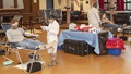 A service member donates convalescent plasma at a blood donation center.