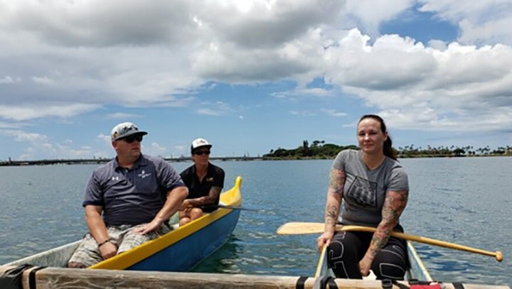 Caregiver Stacey Rivera and Navy Wounded Warrior staff canoe around Joint Base Pearl Harbor Hickam during the Military Caregiver Workshop. (Photo by Gabrielle Arias, Peer Support Coordinator, DHA Recovery Care Program, San Diego)