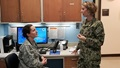 Navy Cmdr. Francesca Cimino, M.D. (standing) confers with a colleague in the Family Medicine department at Uniformed Services University of the Health Sciences in Bethesda, Maryland. (Courtesy photo)
