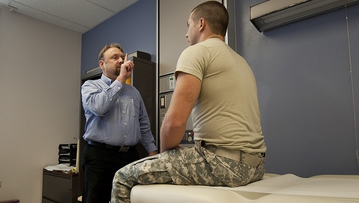 Dr. Gregory Johnson (right), Tripler Concussion Clinic medical director, has Army Spc. Andrew Karamatic, Department of Medicine combat medic, follow his finger with his eyes during a neurologic exam at Tripler Army Medical Center, Honolulu. (U.S. Air Force photo by Staff Sgt. Christopher Hubenthal)