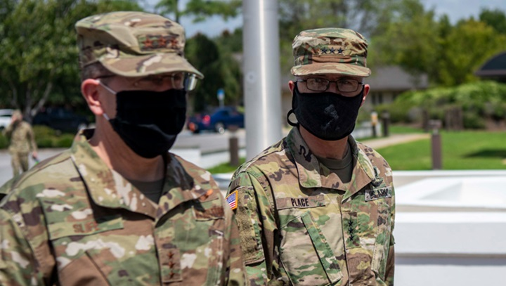 Two soldiers in masks, talking