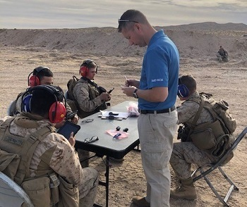 Scientist checking hearing equipment for four servicemen