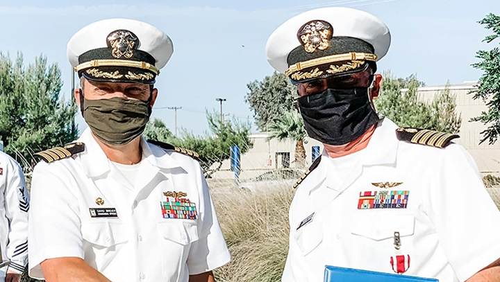 Two medical officers wearing masks