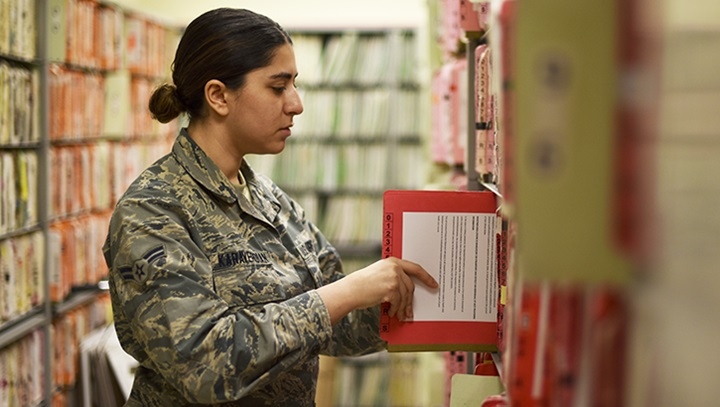 Image of soldier putting away a paper file