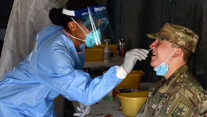 Army soldier gets nose swab