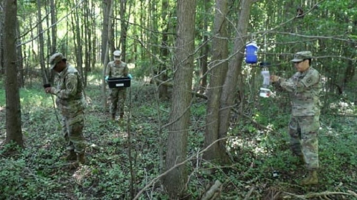 Group of people in forest gathering samples