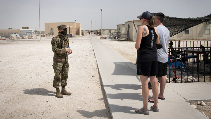U.S. Air Force Tech. Sgt. Nathan Davis, conducts a weekly Disaster Mental Health battlefield circulation walk around Quarantine Town.