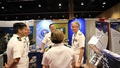 Navy Medicine West Commander Rear Adm. Tim Weber (right) discusses research findings with scientists from Navy Medicine's hospitals and research labs during the first poster session at the 2019 Military Health System Research Symposium. (U.S. Navy photo By Regena Kowitz)