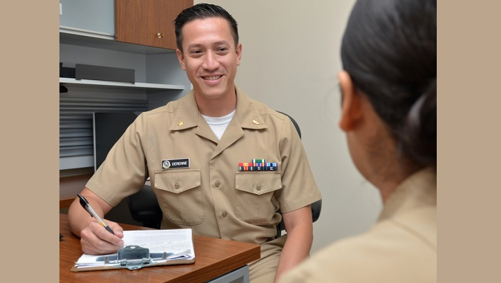 "Navy Lt. Cmdr. John Derenne, a psychiatrist at Naval Hospital Jacksonville, discusses mental health and resiliency at the hospital's Behavioral Health Clinic. Derenne, a native of Orange, California, says, ""Mental health challenges should not be hidden or ignored; seeking help early is a sign of strength. Just like physical fitness, good mental health is integral to your well-being and mission readiness."" (U.S. Navy photo by Jacob Sippel)"