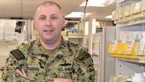 Navy personnel in a pharmacy