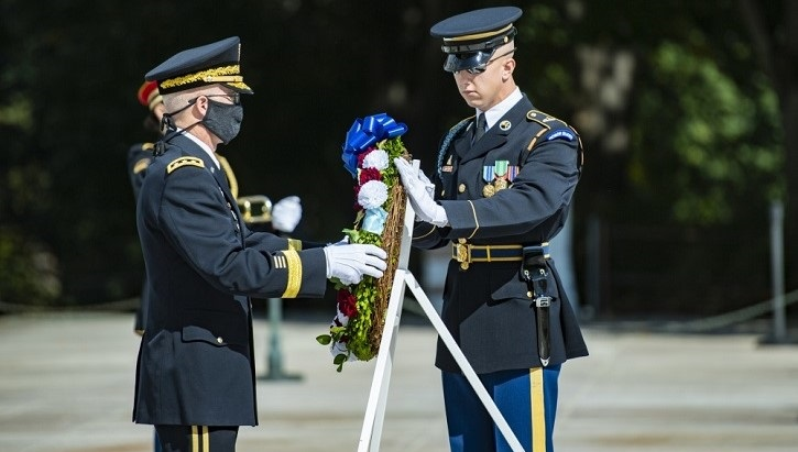 Lt. Gen. Ronald Place holding a wreath at Arlington National Cemetery