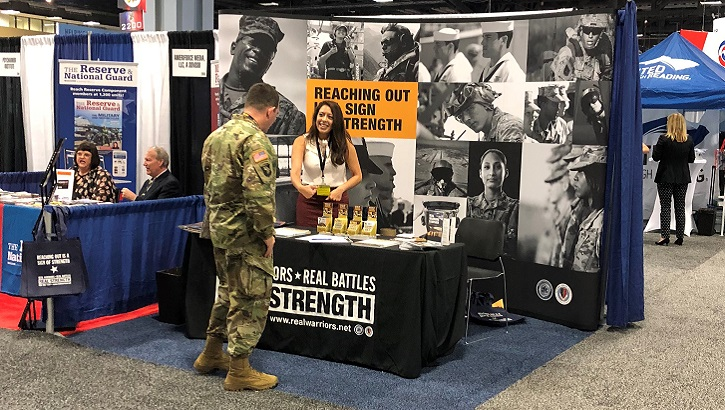 The Real Warriors Campaign member engages with a service member at the Association of the United States Army Annual Meeting and Exposition in Washington, D.C. (Courtesy photo)