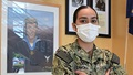 Picture of military health personnel wearing a face mask posing