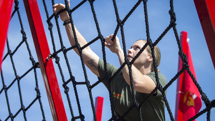 Image of a Marine climbing a rope ladder