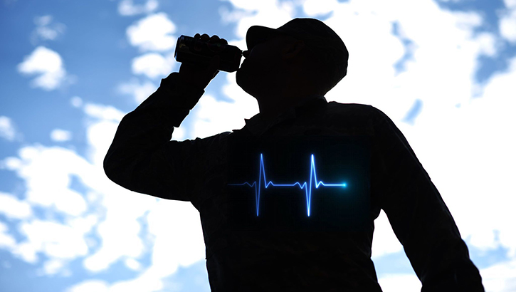 Image of man drinking from a water bottle