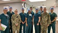 The Army, Navy and Air Force surgeons and physician assistant met with the hospital command team. (Left to right) Army Col. Alfonso Alarcon, orthopedic surgeon at BDAACH; Army Maj. Harry Aubin, general surgeon at BDAACH; Army Command Sgt. Maj. Nicole Haines, the hospital senior enlisted advisor; Air Force Capt. Christopher Ng, Air Force general surgeon with 51st MDG; Army Maj. Eric de la Cruz, chief of general surgery at BDAACH; Navy Lt. Cmdr. Paul Lewis and Lt. Cmdr. Dan Sanford, general surgeons with 3rd Medical Battalion; Army Maj. John Fletcher, general surgeon at BDAACH; Army Col. Andrew L. Landers, hospital commander, and Air Force Capt. Steven Maya, physician assistant with 51st MDG. (U.S. Army photo by Inkyeong Yun)