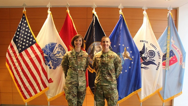 Air Force Maj. Nicole Ward, left, and Capt. Matthew Muncey, program managers with the Air Force Medical Service Transition Cell, at the Defense Health Headquarters in Falls Church, Virginia, Jan. 9, 2020. (U.S. Air Force photo by Josh Mahler)