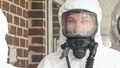 Woman in white chemical suit