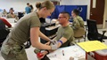 Army Sgt. Charles Moncayo, 82nd Airborne Division Band, get his blood drawn as part of the low titer O testing at a blood drive hosted by the 82nd Airborne Division Artillery. The XVIII Airborne Corps is identifying Soldiers with blood type O who have low levels of antibodies in their blood. These individuals have the ability to provide an immediate blood donation to an injured person of any blood type that needs a transfusion at or near the point of injury. (U.S. Army photo Eve Meinhardt)
