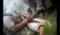 U.S. Air Force Senior Airman Michael Triana, left, 347th Operations Support Squadron independent duty medical technician-paramedic, addresses injuries on a simulated patient during a tactical combat casualty care course, in Okeechobee, Florida. The course tests and reinforces participants' lifesaving medical skills while they are in high-stress, combat scenarios. (U.S. Air Force photo by Staff Sgt. Ryan Callaghan)