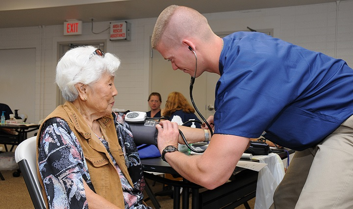 Air Force Staff Sgt. Nick Crouse, a medical technician with the 193rd Special Operations Wing's Medical Group out of Middletown, Pennsylvania, takes the blood pressure of a patient. Heart disease, diabetes, and chronic obstructive pulmonary disease are three ailments that take a huge toll on the body as it ages. (U.S. Air Force photo)