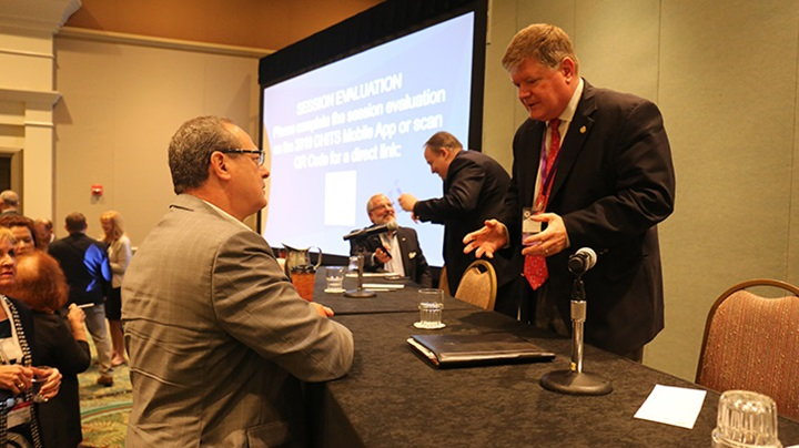 "Chris Harrington, deputy assistant director of the Defense Health Agency's Information Operations Solution Delivery Division, interacts with an attendee at the 2019 Defense Health Information Technology Symposium. Harrington spoke about DoD-VA collaboration on Wednesday, July 31, during a breakout session at DHITS. The theme of this year's DHA-sponsored event is ""One Team, One Mission – Enabling MHS Transformation."" (MHS photo)"