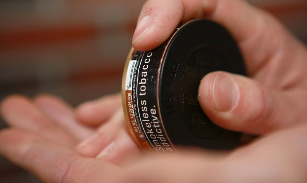 Smokeless tobacco is not a healthier alternative to smoking. Links exist to its use and several cancers – not to mention leathery patches in the mouth, stained teeth, and bad breath. Users can take advantage of the Great American Spit Out Feb. 20 to begin their path to a tobacco-free lifestyle. (U.S. Marine Corps photo by Cpl. Paul Peterson)