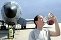 Generally our bodies are comprised of approximately 60 to 70 percent water. We need water for digestion, energy and oxygen transport, and temperature regulation. Senior Airman Johanna Magner, 22nd Aircraft Maintenance Squadron crew chief, drinks water on the flightline in front of a KC-135 Stratotanker. With rising temperatures during the summer months people are encouraged to drink more water to stay hydrated. (U.S. Air Force photo by Airman 1st Class Jenna K. Caldwell)