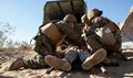 Hospital corpsmen and Marines check a simulated casualty and remove their body armor during Exercise Steel Night's mass casualty drill at Marine Corps Air Ground Combat Center Twentynine Palms, Calif., Dec. 12, 2015. The drill tested the 1st Marine Division's ability to react to a large influx of injuries and wounds from battling the enemy. Steel Knight provides tough, realistic training for the Marines and sailors of 1st Marine Division.