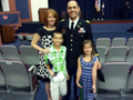 Image of a service member and his family